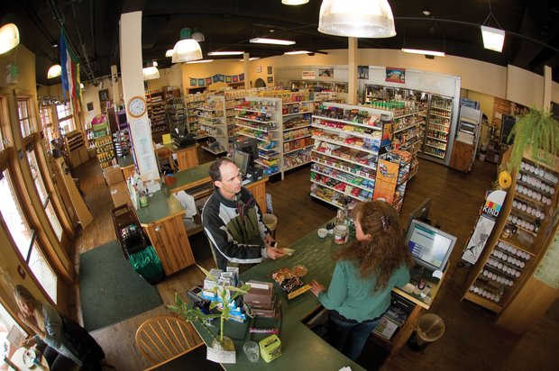 David High visits with clerk Barb Lynn while checking out at Bamboo Market. The business is celebrating its 20th year in Steamboat Springs.